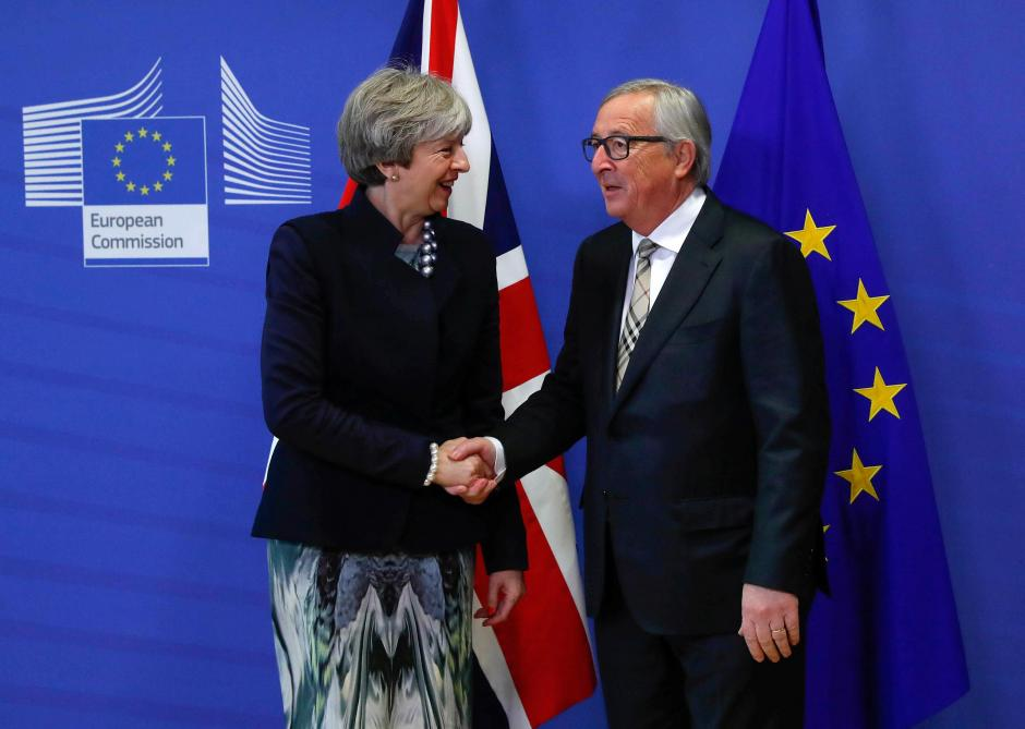 Theresa May et Jean-Claude Juncker © Reuters
