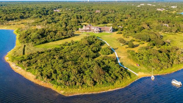 barack and michelle obama are reportedly planning to buy a huge estate in martha's vineyard, massachusetts.  the property is on the market for $14.85 million and features seven-bedrooms and nine bathrooms inside the 6,982 square foot main residence.  the home was originally put up for sale by from â??boston celticsâ?? owner wyc grousbeck in 2015 for $22.5 million. in 2017, it was reduced to $16.25 million before a further cut to the current asking price.   the former president and first lady rented out the home for the summer and reportedly loved it so much that they made an offer to buy it.  real estate insiders claim they havenâ??t paid the full asking price.  inside the main home, thereâ??s a chef's kitchen, and formal dining room surrounded by a wall of windows. the huge master bedroom suite opens up to a sundeck. outside, thereâ??s a pool and 29 acres including a private beach.   the obamas won't be the first presidential family to buy up on the massachusetts island.  jackie kennedy-onassis kept a home there until her death in 1994, and the summer resort was popular with the whole kennedy dynasty.   estate agent tom wallace said:â? it's a remarkable home on an absolutely gorgeous setting. it certainly has the capacity to expand to more of a compound. one could build two additional full-size properties.  their new home is on the edge of edgartown great pond, with views of the atlantic ocean.